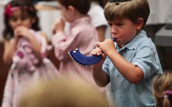 Boy-blows-shofar-during-Jewish-New-Year.jpg