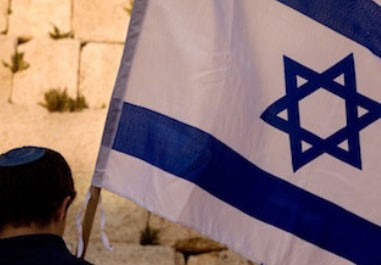 man-helped-by-Jewish-Federation-holds-Israeli-flag