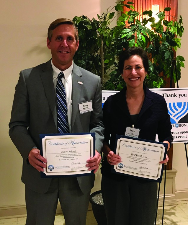 Man holding certificate of recognition for Charles Schwab standing next to woman holding certificate of recognition for MVP Healthcare