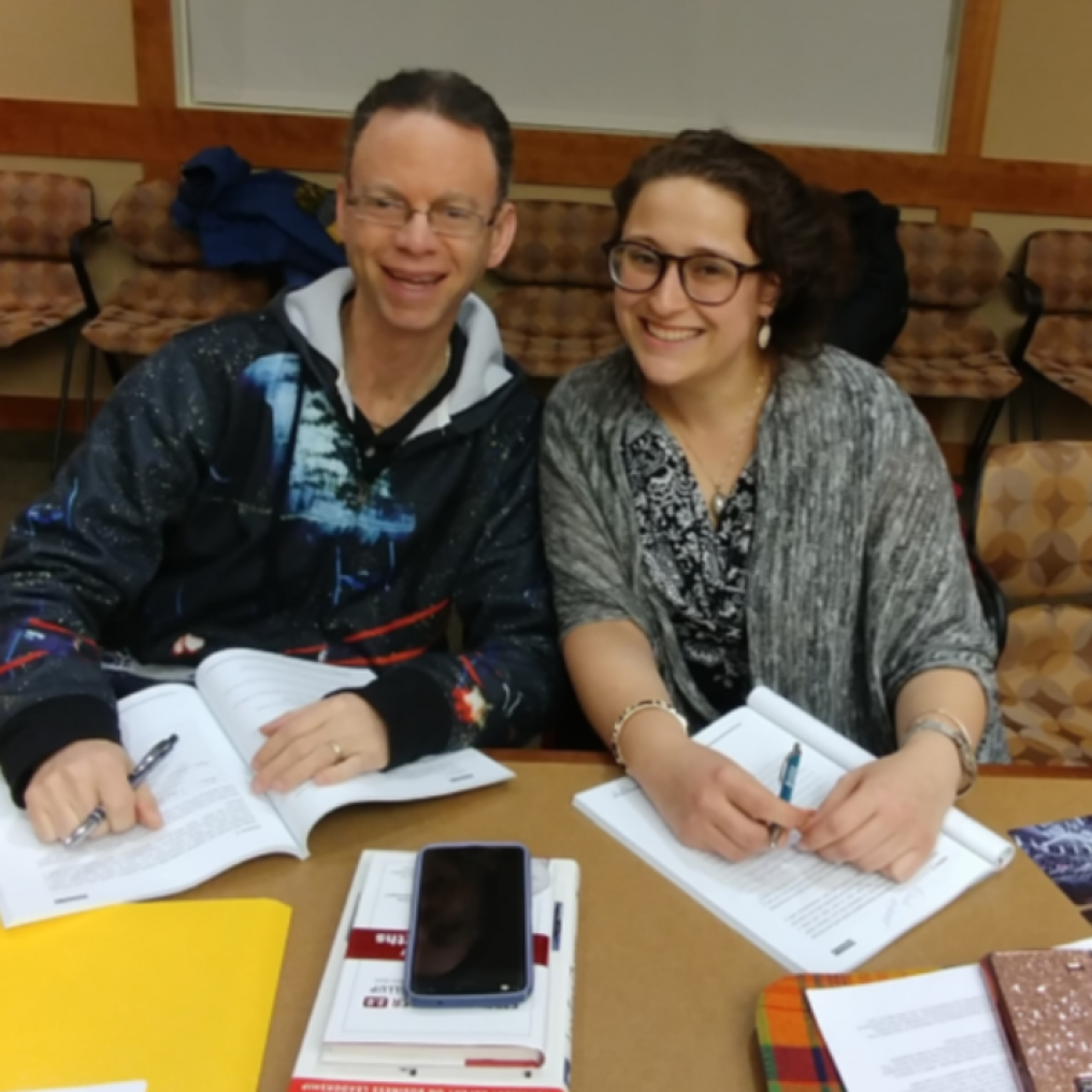 A man and a woman smiling for a picture during a Leadership Training class at Jewish Federation of Northeastern New York