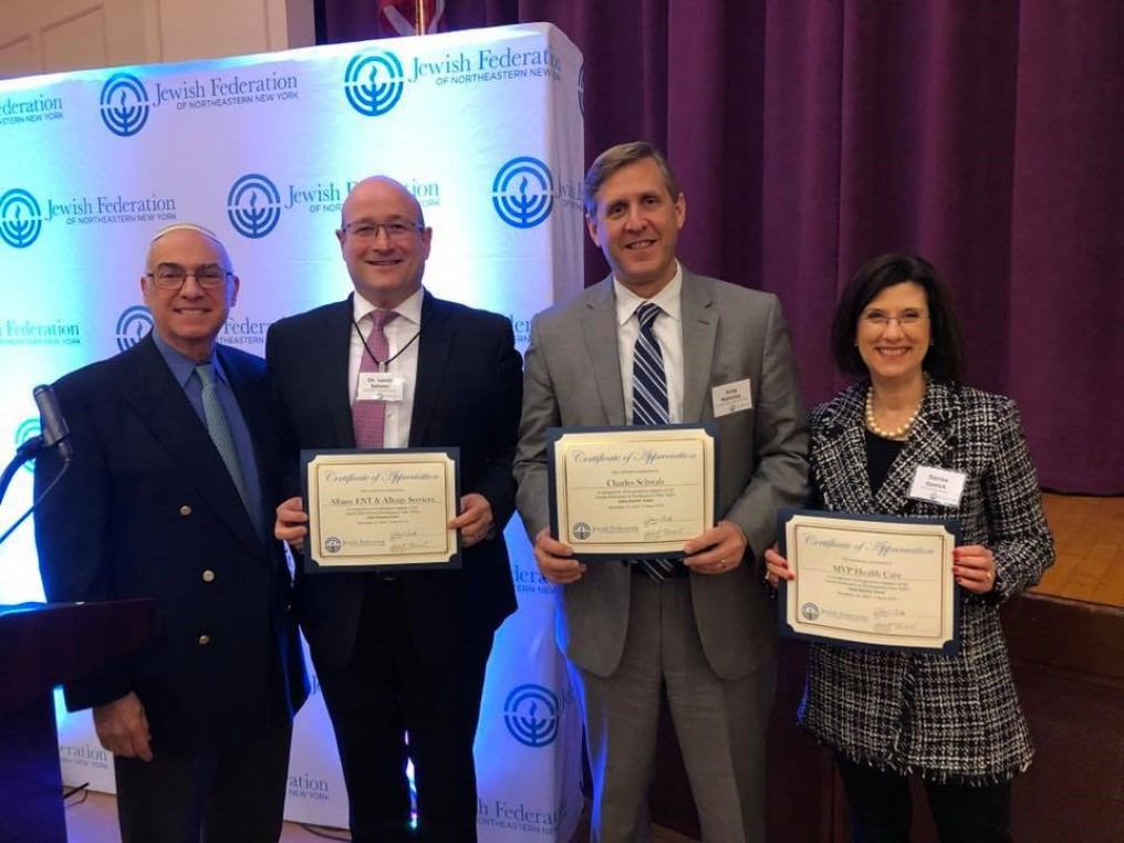 Past Federation chair, Louis-Jack, standing next to representatives from Albany ENT & Allergy Services, Charles Schwab, and MVP Health Care holding certificates of recognition
