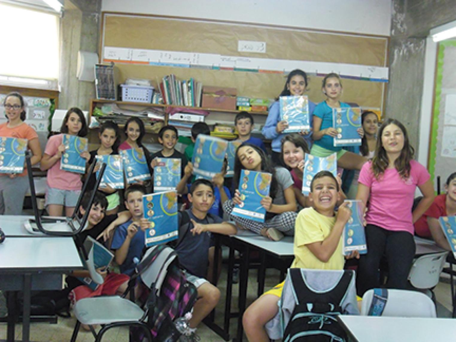 Friends Across the Sea- Israeli Children Holding Up Books