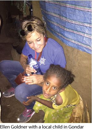 Ellen Goldner with a local child in Gondar