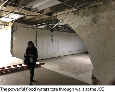 The powerful flood waters tore through walls at the JCC