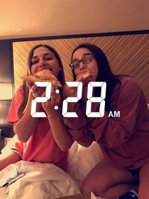 Hannah Wise and Yael Friedstrom enjoy their late-night pizza while spending the night at an airport hotel in Newark.