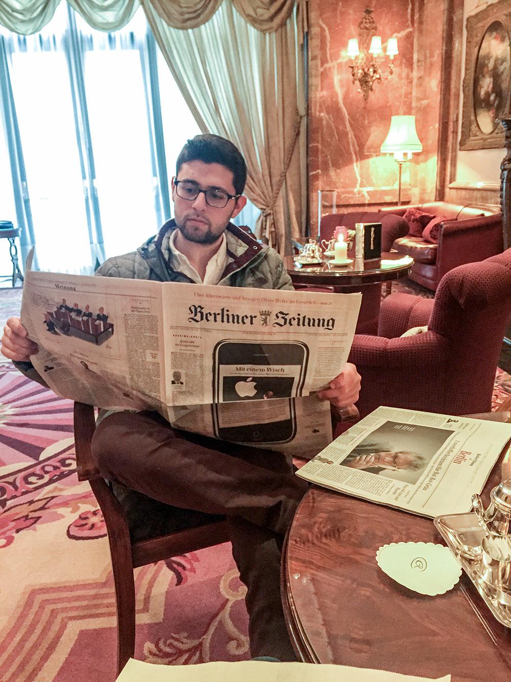 Elan reading a German newspaper