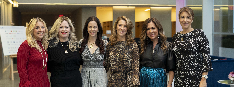 6 women posing at an event