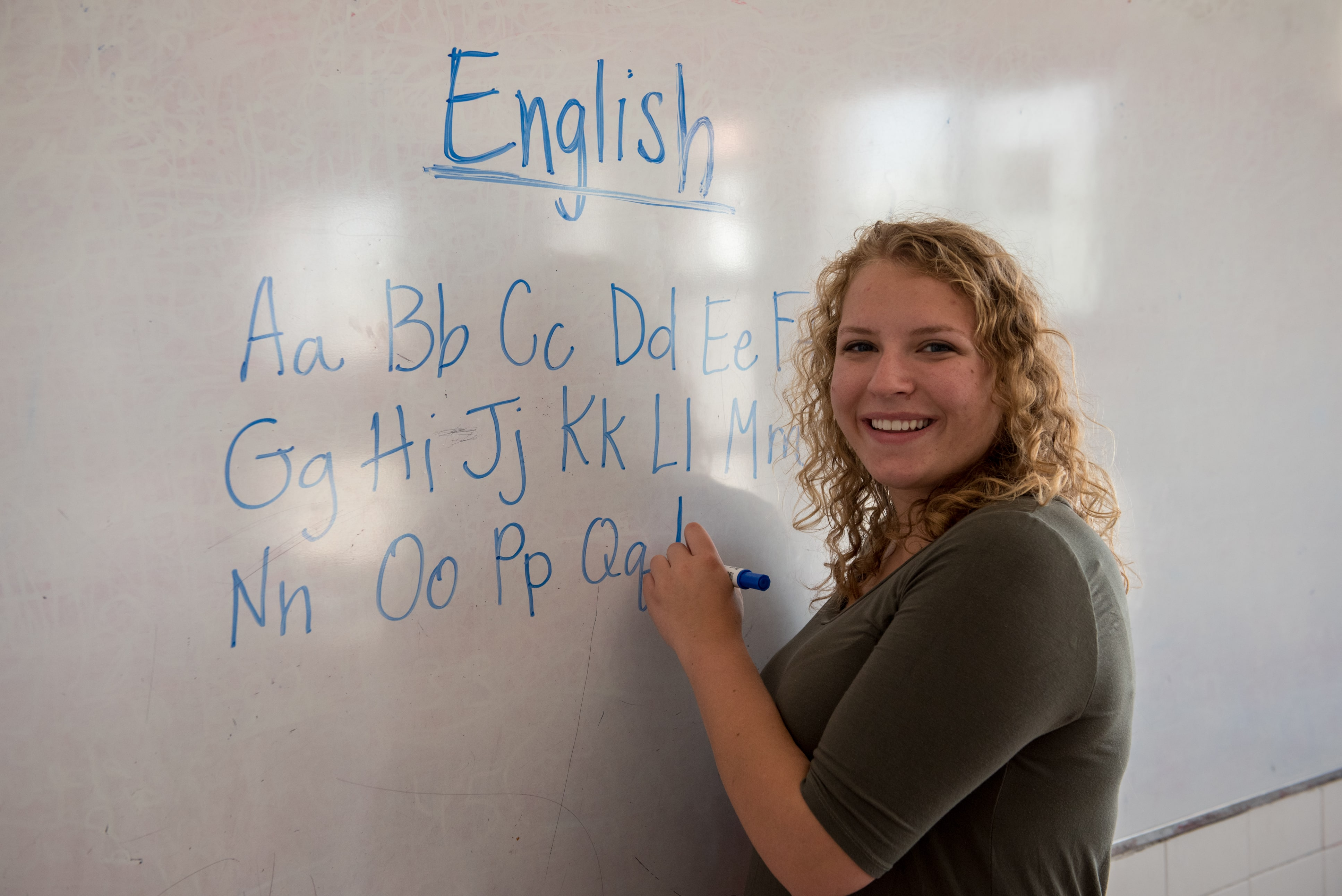 A young woman teaching ABC's