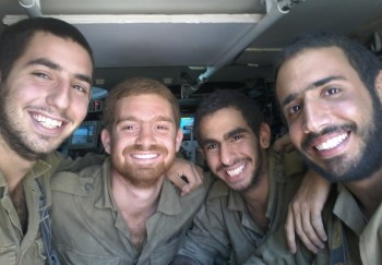 Ron Gordon, left, who joined the Israel Defense Forces after growing up abroad, says lone soldiers act as surrogate family for each other after they leave the battlefield.