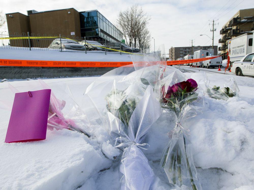 Bouquets lay in the snow near the entrance to the Centre Culturel Islamique de Québec (background) in Quebec City Jan. 30, 2017.Phil Carpenter / Montreal Gazette