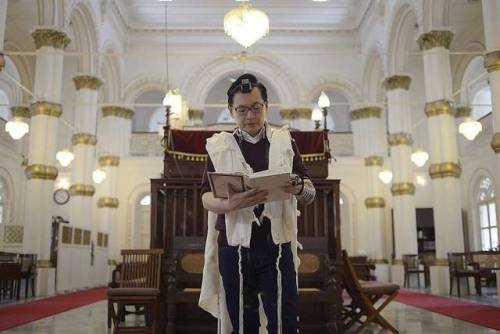 Jewish man prays at the Chesed-El Synagogue in Singapore; 2016.